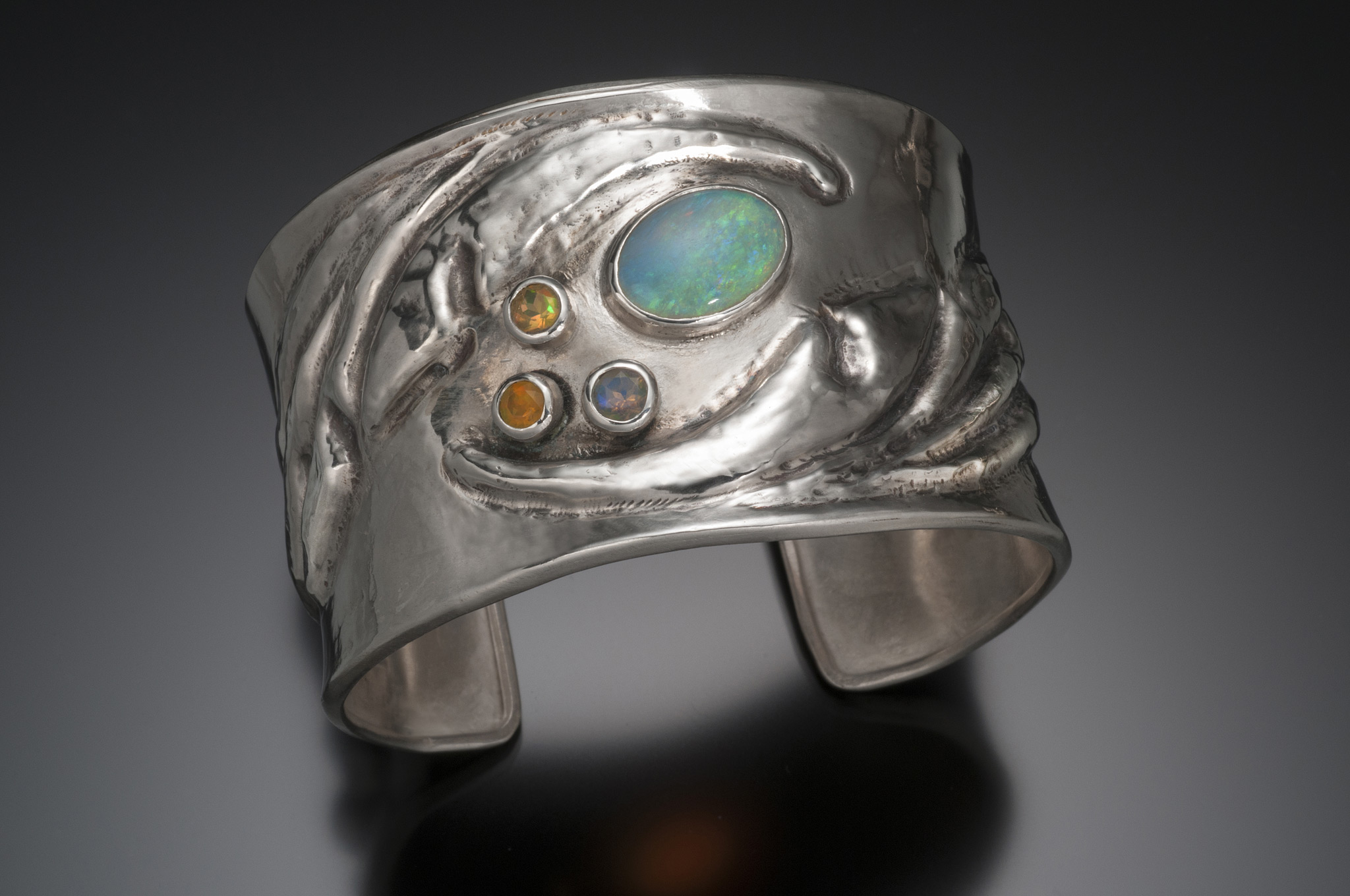 Chasing and repousse cuff bracelet with opals